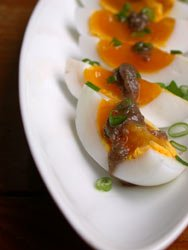 soft cooked duck eggs with warm anchovy vinegarette