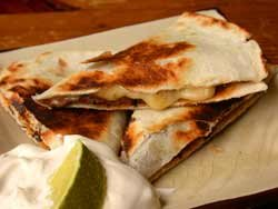 Black Bean Pumpkin Seed Quesadilla with sour cream